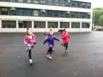 Running in the rain at Girls on the Run practice
